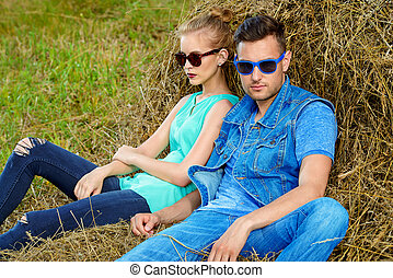 haystack nature - Fashionable models wearing jeans clothes...