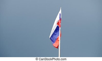 Slovak flag in the wind - Slovak flag blowing in the wind on...