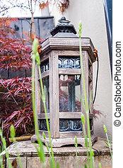 Image of garden still life with lantern