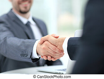 Closeup of a business handshake. Business people shaking...
