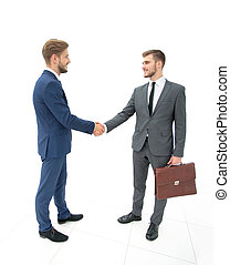Two businessmen making agreement, their colleagues standing...