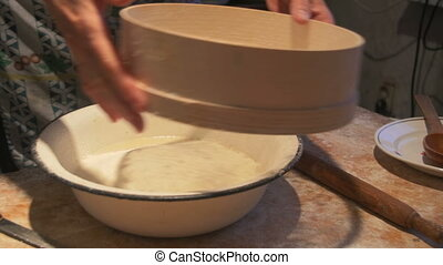 Woman mixer whisking dough - Woman making fresh dough in a...