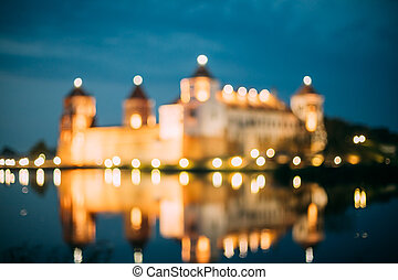 Mir Belarus. Blurred Boke Bokeh Focus Of Mir Castle In Night...