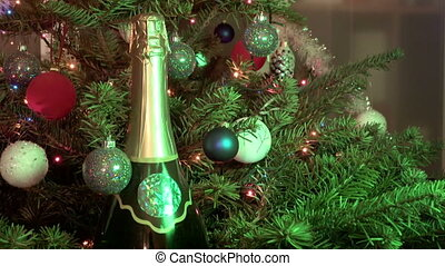 sparkling wine champagne among the Christmas fir-tree...