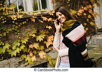 Woman with telephon outdoor - Young woman with mobile phone...