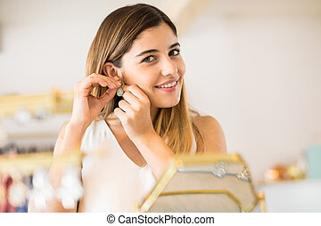 Woman buying some jewelry and smiling - Portrait of a...
