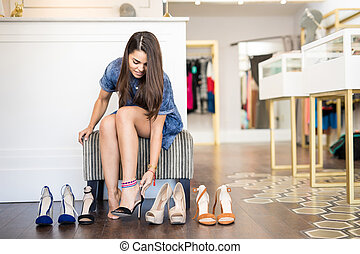 Beautiful girl trying on some shoes