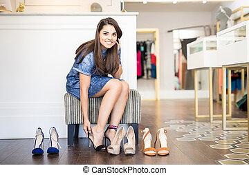 Cute Latin woman buying shoes