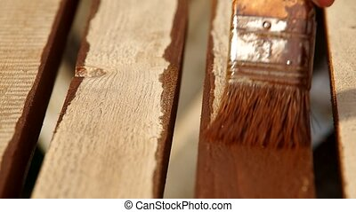 Painting wood - Wood painting with a brush with the brown...