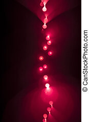 Background of red LED lights with bokeh effect