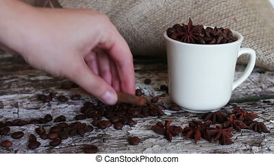 White cup full of coffee beans closeup - white cup full of...