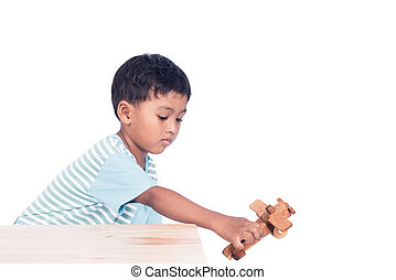 cute child asian boy playing wooden plane