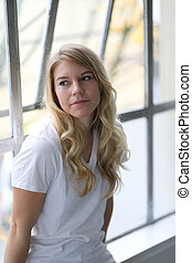 Head Shot of a Beautiful Blond Woman with Brown Eyes - Photo...
