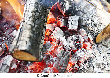 red coals in the fire - photographed close-up red embers...