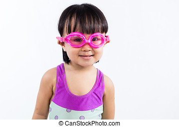 Asian Chinese little girl portrait wearing goggles and...