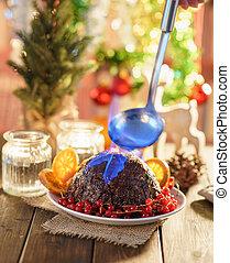 Christmas pudding flambe