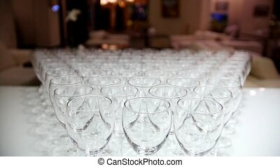 A lot of empty glasses on white table, close up