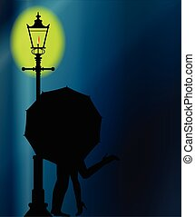 Kissing In The Dark - A couple kissing in the night by the...