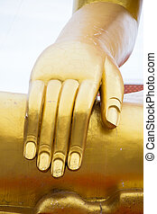 Golden Buddha statue hand sing of peace and concentration posture.