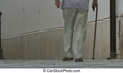 Old Man Walking with Cane - Old man walking with cane along...