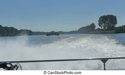 Rear Deck View of Cruising Ship - White foamy slipstream at...