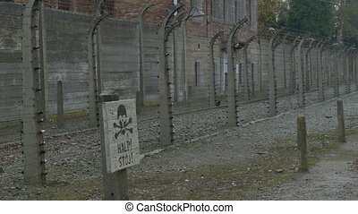 Electric Fence Sign on Nazi Camp - The dath sign painted on...