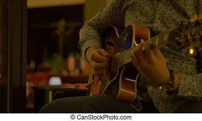 Outdoor Night Guitarist - Jazzy guitarist performing outdoor...