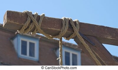 Hanging Rope in Wind - A medieval hanging swinging gently in...