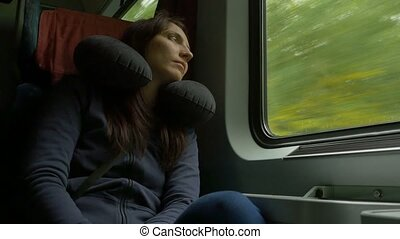 Woman Travelling by Train - Woman is sleeping in the car...
