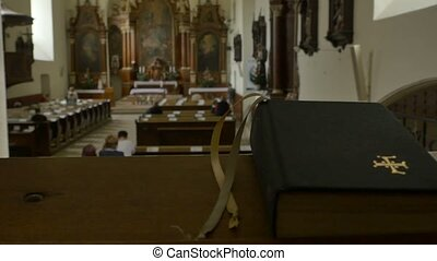 People Assist the Catholic Sermon - A praying book and...