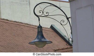 OLd Lantern Swinging in Wind - Medieval lantern on the...