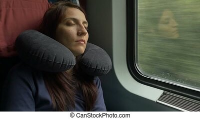 Woman Sleeping in Train - Woman is sleeping in the car while...
