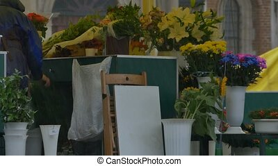 Rain at Flower Market - Potted flowers and bouquets on a...