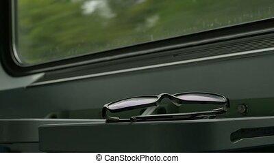 Eyeglasses in the Train - Passenger put the eyeglasses on...