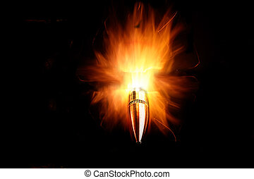 Bullet on Fire - Rifle bullet with bright flames on black...