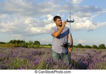 Horizontal shot of land surveying work