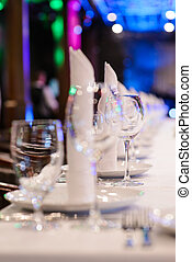 Empty wine glasses on a table in a nightclub. - Wine...