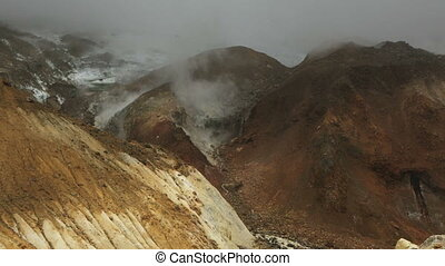 Stream from the melting of glaciers on active volcano Mutnovsky stock footage video