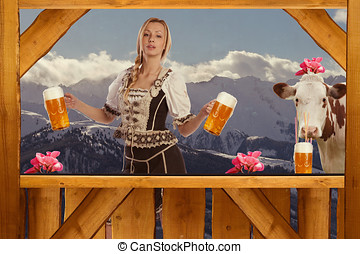 Woman in Tirol Oktoberfest look serving beer - Beautiful...