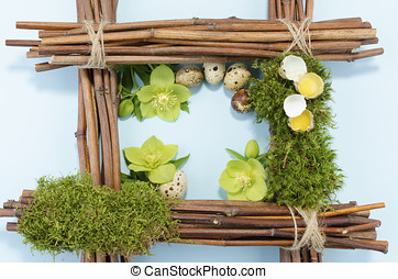 Easter frame with two raw and five boiled quail eggs and...