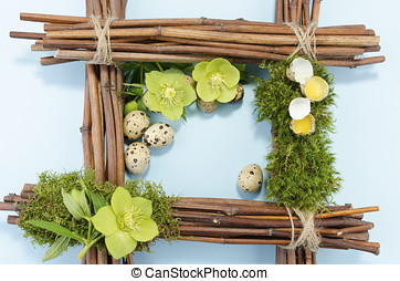 Easter frame with one boiled quail egg in the right corner...