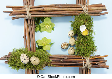 Eastre frame with six quail eggs and two hellebore flowers
