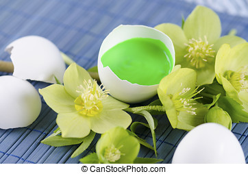Colorful Easter decoration with egg shell filled with green...