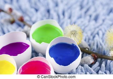 Easter decoration with egg shells and filled with tempera...