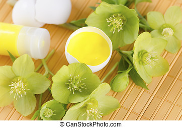 Easter decoration with egg shells on a yellow pad plus...