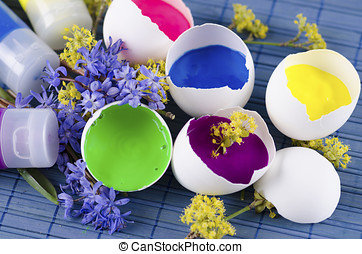 Easter decoration with five egg shells and three paint tubes