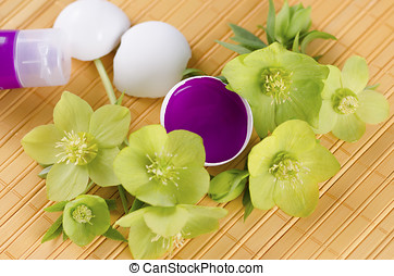Easter decoration with hellebore and egg shells and magenta...