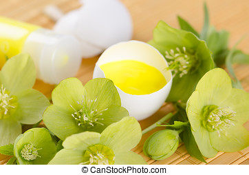 Easter decoration with yellow paint in a egg shell and...