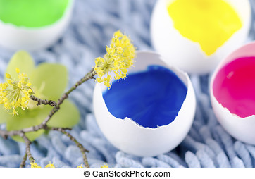 Easter eggs shells filled with paints