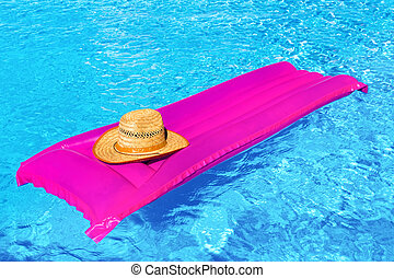 Pink air mattrass with hat in swimming pool - Pink air bed...